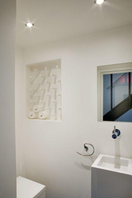 Sistemare carta igienica