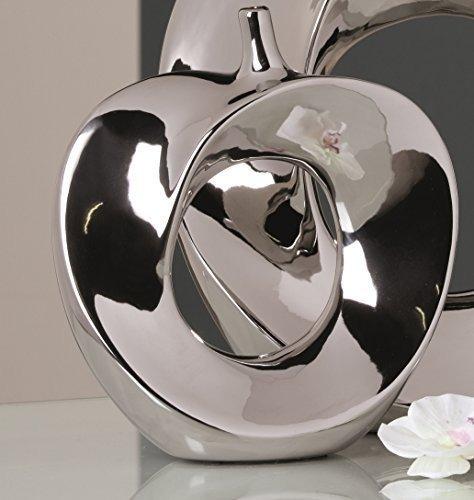 Vaso color argento a forma di mela, ideale come decorazione sopra mobile.