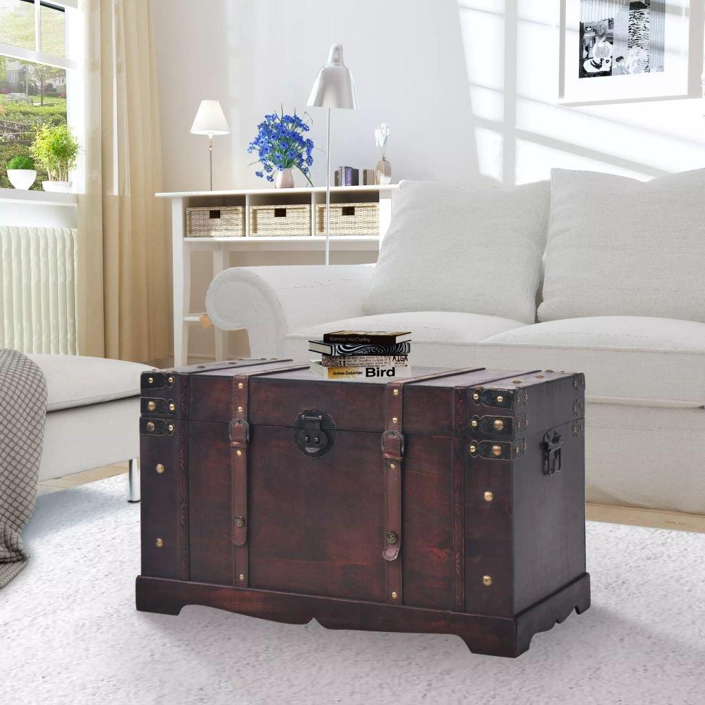 Bellissimo baule in legno con cinghie in pelle, ideale per un tavolino vintage in salotto.