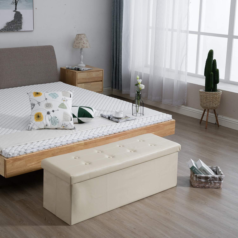 Panca beige imbottita con contenitore per camera da letto.